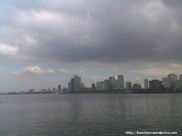 view of Manila Skyline from the dock at the CCP Complex